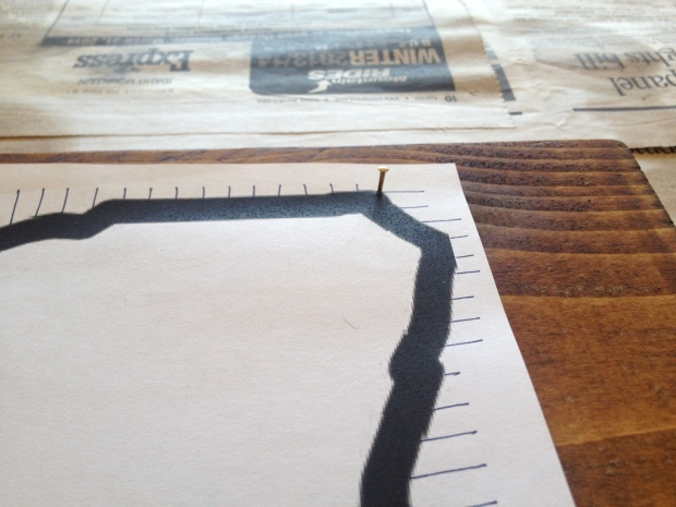 nail each corner down after your paper is centered