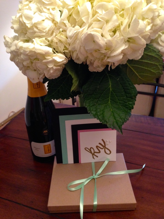 my go-to birthday present combo — a handmade cards, prosecco, fresh flowers, and a pretty package