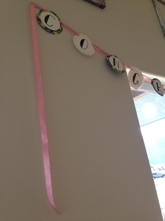 be sure to leave a long tail of ribbon — even if you don't use it to hang the sign, it's pretty!