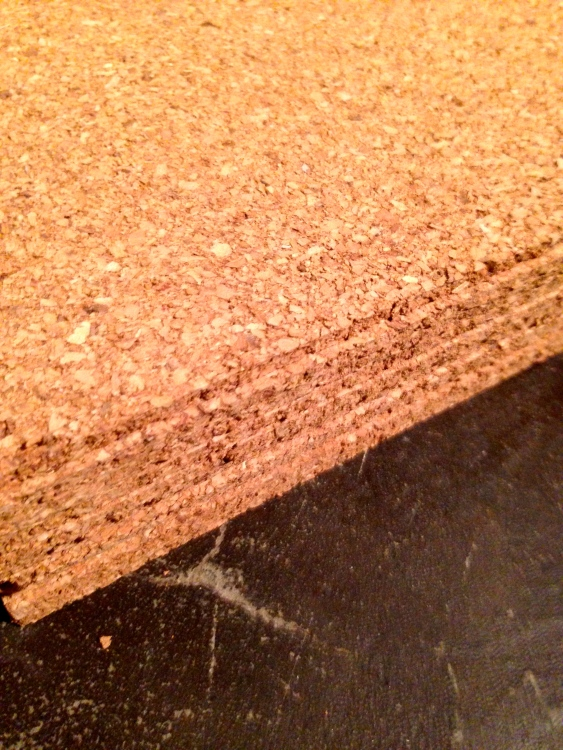 a couple packages full of square cork board from Target