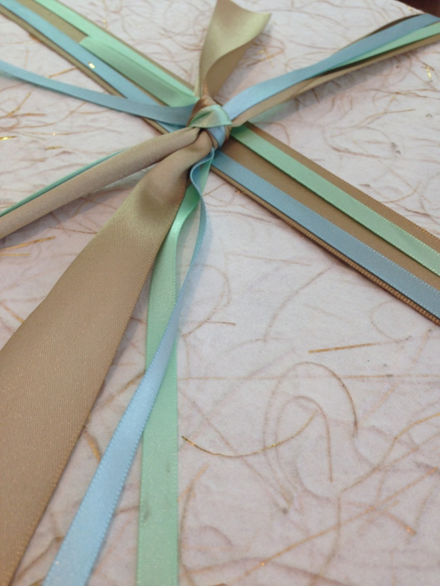 three different colored satin ribbons in different widths added some color and dramatic lines