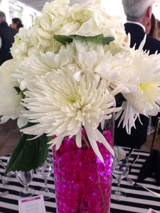 pretty bouquets in bright pink vases