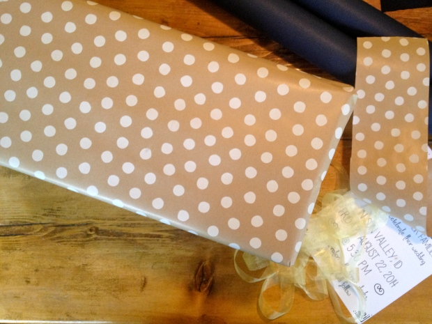 box wrapped in natural colored polka-dot paper