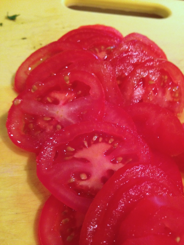 slice the basil and the tomatoes as thinly as possible