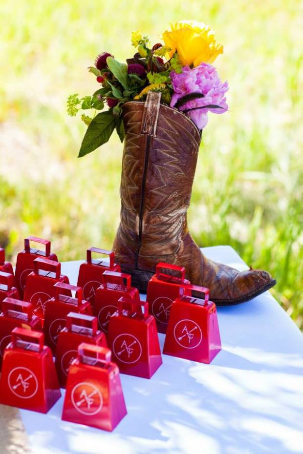 branded cow bells at the wedding of ashley howe and tj lanning