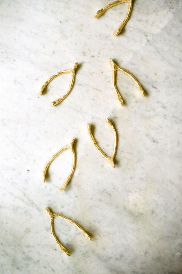gold wishbones from Style Me Pretty