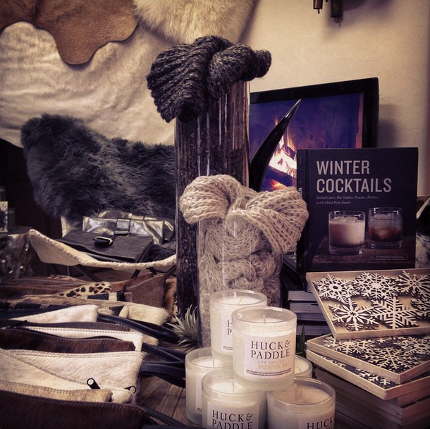 a lovely display, including their soy wax candles, which are made in house and feature Brambleberry essential oils...and some amazing leather clutches